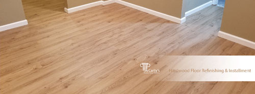 Hardwood Floor Refinishing and Installment by McCarty's Quality Home Exteriors